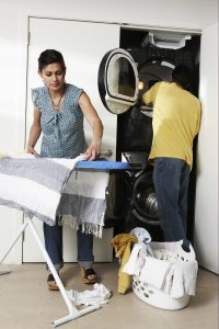 Couple doing laundry in utility room (Photo by Thinkstock)