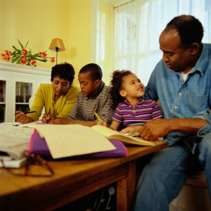 Parents Helping Their Children With Homework (Photo by Thinkstock)