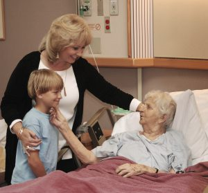 Family visiting grandmother in hospice (Photo by Thinkstock)