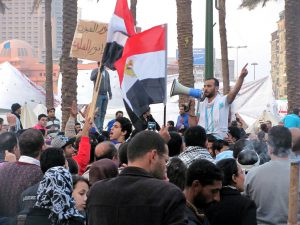 Protesters gather in Tahrir Square on election day, 12/02/2011. Photo by Muhammad Moneib (mmoneib), available on Flickr under a Creative Commons license. Click image for higher resolution.