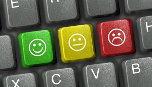 Keyboard close-up with three smiley keys (Photo by Thinkstock)