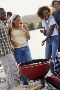 Group of young people at a barbecue (Photo by Thinkstock)