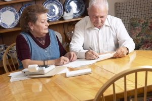 Older couple paying bills (Photo by Thinkstock)