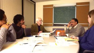 James Jackson in a meeting with Bob Kahn and students