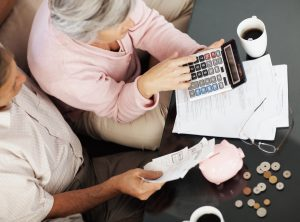 Elderly couple calculating their personal finances at home (Thinkstock)