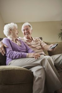 Couple relaxing at home. Photo by Thinkstock.