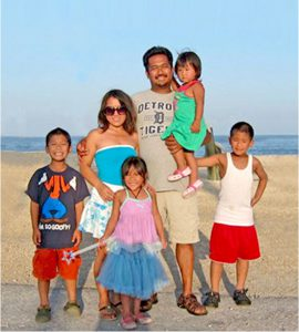 Vuthy Pen and family at ocean