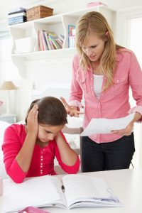 Mother Telling Daughter Off For Bad School Report