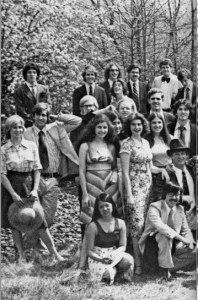 A group of young men and women posing for a photo