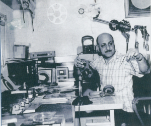 "Leo Sarkisian prepares for the first ""Music Time in Africa"" broadcast in Monrovia, Liberia in 1965."