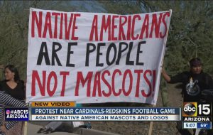 Group protests Washington's NFL mascot before Arizona Cardinals game.