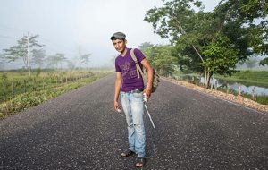 Man in the middle of a road