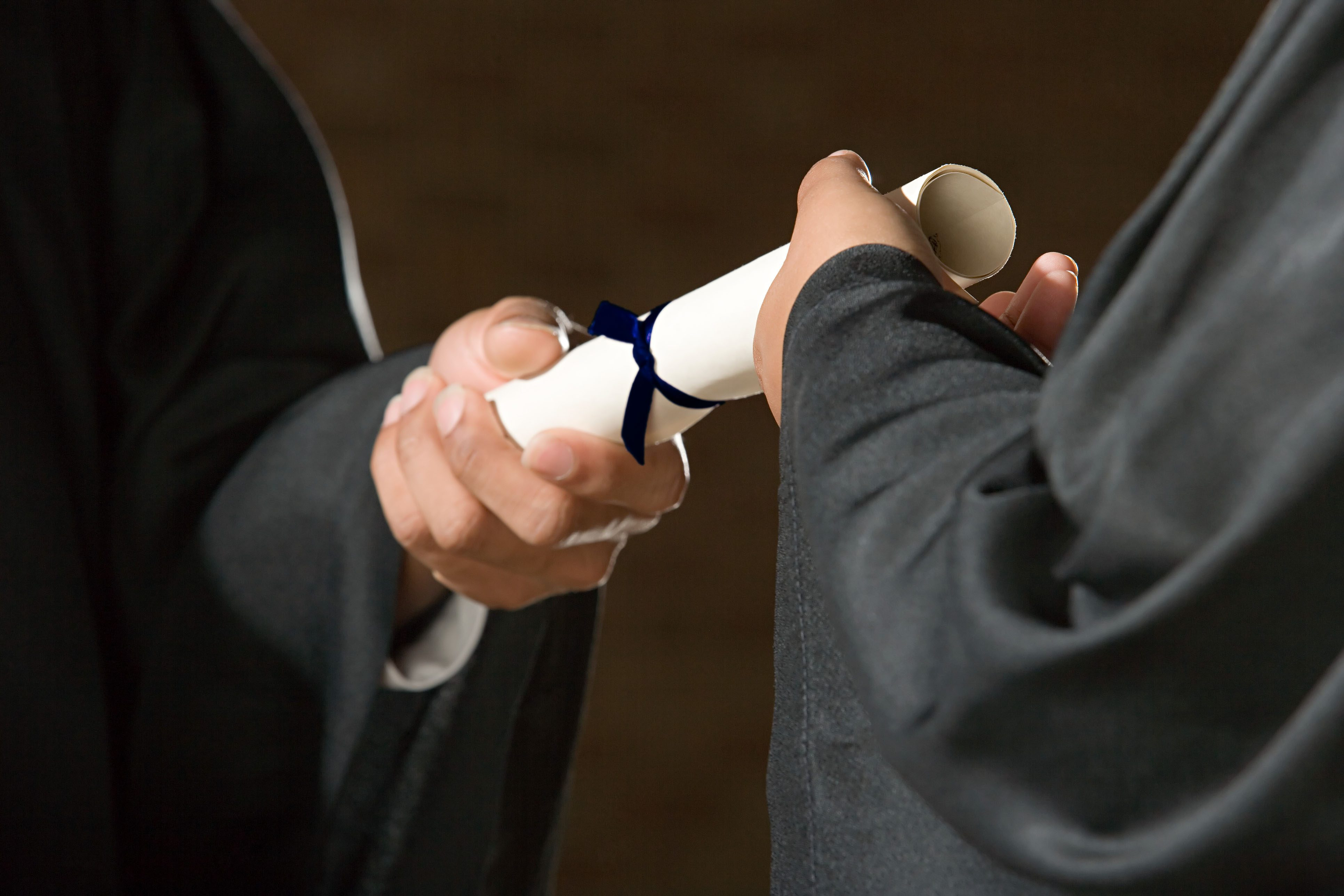 A graduate getting a diploma